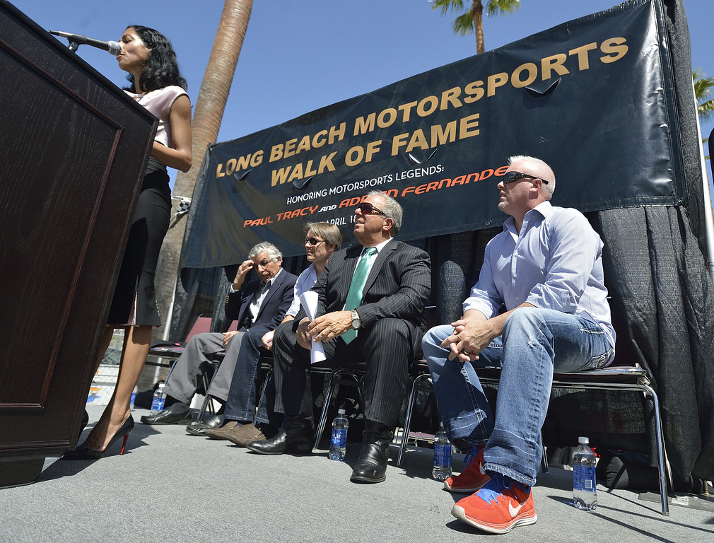 . LONG BEACH, CALIF. USA --  Jim Michaelian, President & CEO of the Long Beach Grand Prix, left, Adrian Fernandez, Mayor Bob Foster, and Paul Tracy, right, listen as Council member Suja Lowenthal opens the Long Beach (Calif.) Motorsports Grand Prix Walk of Fame induction ceremony on April 18, 2013. This year include Paul Tracy of Canada and Adrian Fernandez of Mexico. The annual Long Beach Motorsports Walk of Fame induction ceremony occurs in April of each year the Thursday before Toyota Grand Prix of LongBeach raceweekend. Photo by Jeff Gritchen / Los Angeles Newspaper Group