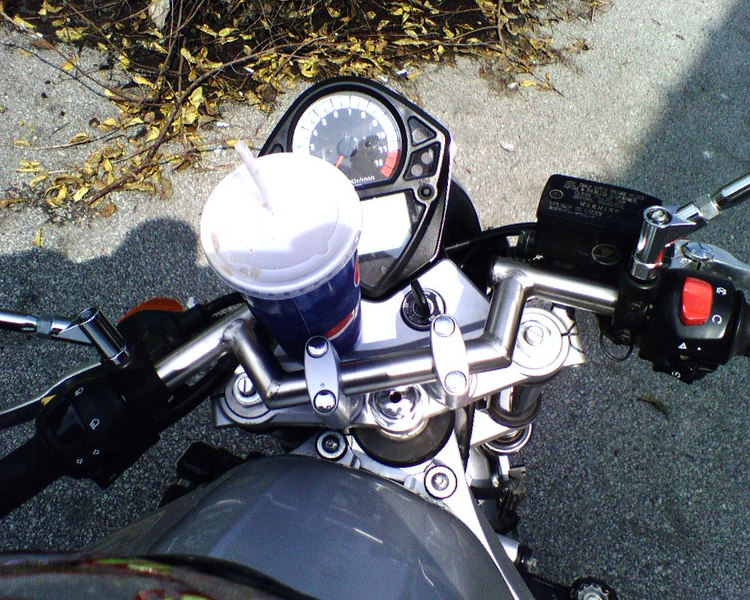 The Consier cup holder What do you think? Nice eh? Demands smooth throttle, clutch, braking and  handling! :) Rode home like that and didn\'t spill a drop :)  Sent from my Sidekick -gc