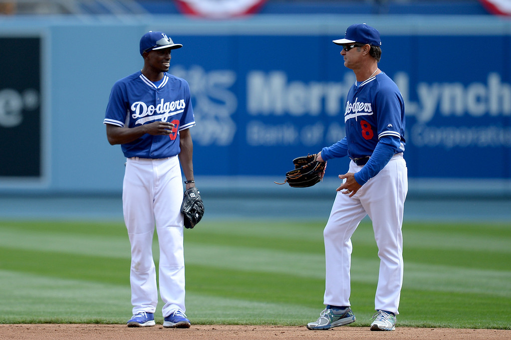 . Second baseman Dee Gordon and Manager Don Mattingly talk during batting practice, Friday, April 4, 2014, at Dodger Stadium. (Photo by Hans Gutknecht/L.A. Daily News)