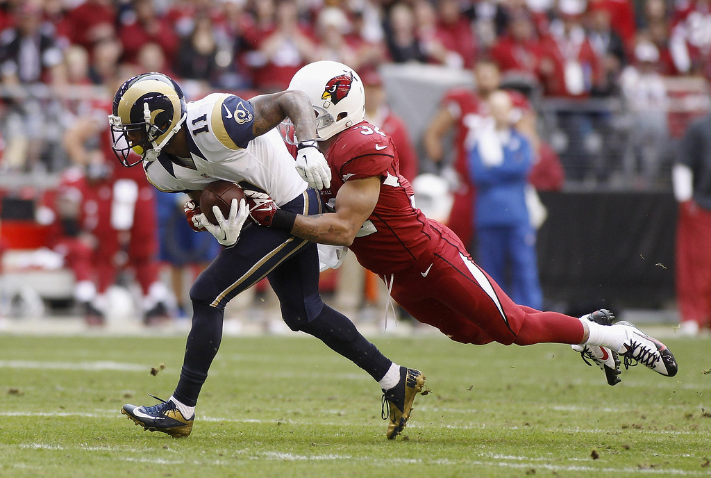 . Tavon Austin #11 of the St Louis Rams is tackled by Tyrann Mathieu #32 of the Arizona Cardinals after a reception during the first quarter of their NFL football game at University of Phoenix Stadium on December 8, 2013 in Glendale, Arizona.  (Photo by Ralph Freso/Getty Images)