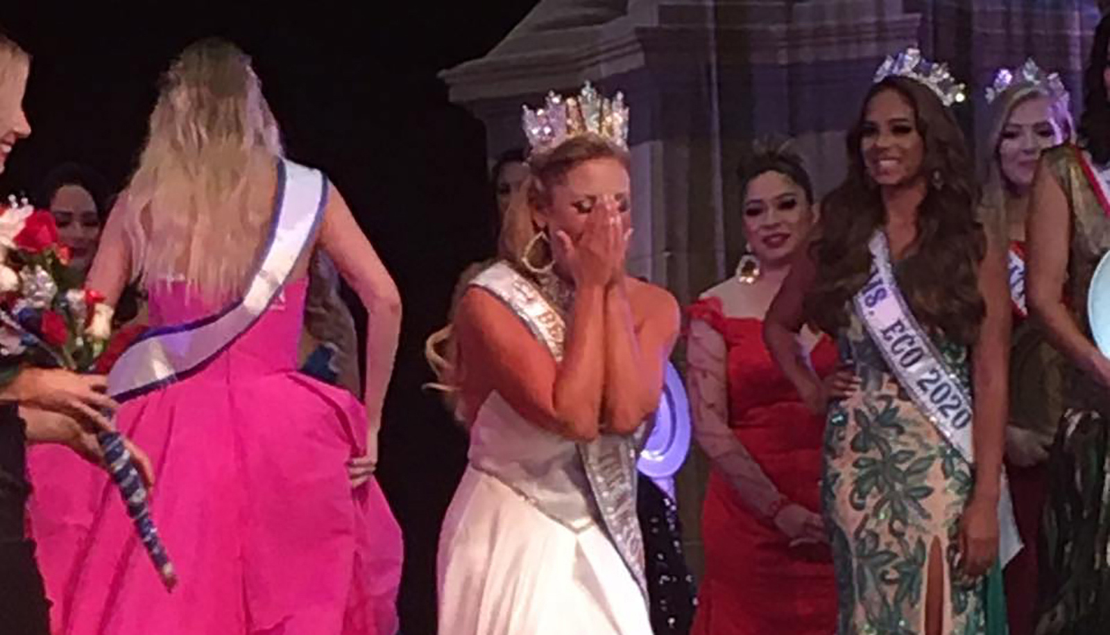 Image for International pageant title holder scores most points on stage and in her community