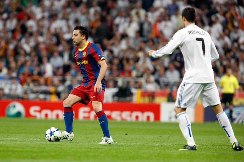 Xavi watched by Cristiano Ronaldo, UEFA Champions League Semifinals game between Real Madrid and FC Barcelona, Bernabeu Stadiumn, Madrid, Spain