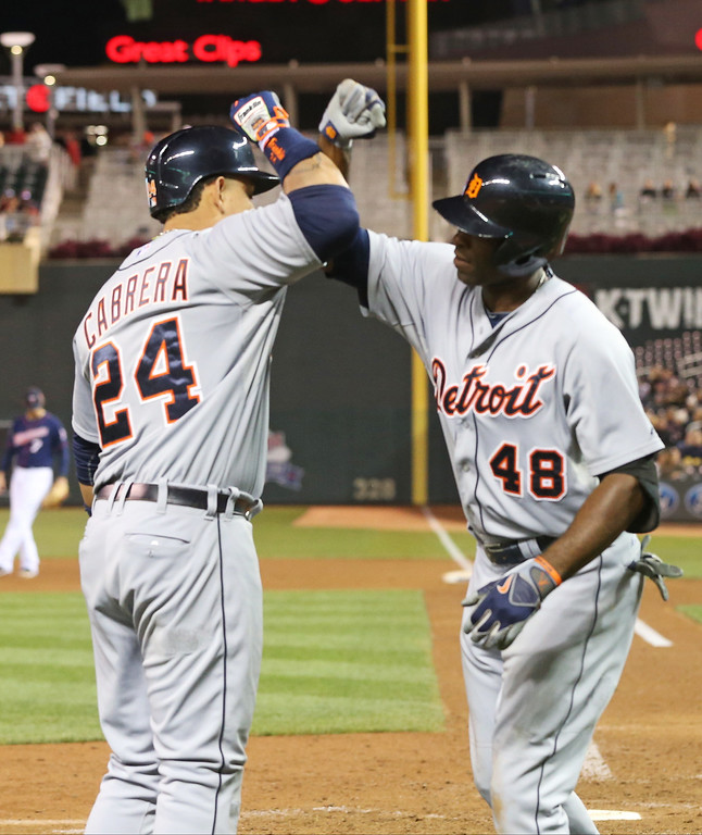 . Detroit Tigers\' Torii Hunter, right, and Miguel Cabrera celebrate Hunter\'s solo home run off Minnesota Twins relief pitcher Casey Fien in the ninth inning of a baseball game, Monday, Sept. 15, 2014, in Minneapolis. Miguel Cabrera followed Hunter with a solo home run moments later. The Tigers won 8-6. (AP Photo/Jim Mone)