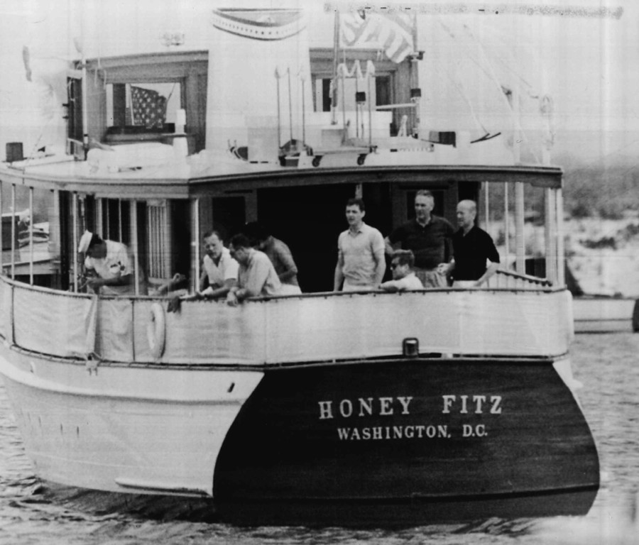 . Kennedy and friends enjoy an afternoon aboard the presidential yacht Honey Fitz off Hyannis Port in 1963. The group includes Lamar Billings; John Reed, Assistant Secretary of Treasury; Patricia Lawford, the president\'s sister; Steven Smith; Gen. Maxwell Taylor and Roland Evans. Denver Post file