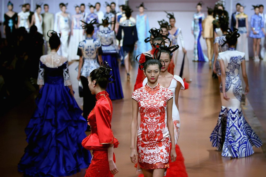 . Models showcase designs by Zhang Zhifeng on the runway at 2014 NE?TIGER Haute Couture Collection show during Mercedes-Benz China Fashion Week Spring/Summer 2014 at Beijing Hotel on October 25, 2013 in Beijing, China.  (Photo by Feng Li/Getty Images)