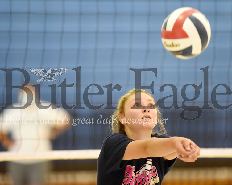 Harold Aughton/Butler Eagle: Butler volleyball senior Sophia Lucas returns a serve while her mother, head varsity coach ?, watches on during an open gym Thursday, June 25, 2020.