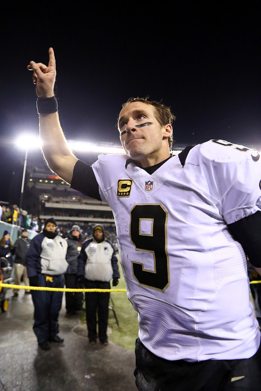 . PHILADELPHIA, PA - JANUARY 04:  Drew Brees #9 of the New Orleans Saints celebrates as he runs off the field after defeating the Philadelphia Eagles in their NFC Wild Card Playoff game at Lincoln Financial Field on January 4, 2014 in Philadelphia, Pennsylvania. The New Orleans Saints defeated the Philadelphia Eagles 26 - 24.  (Photo by Al Bello/Getty Images)