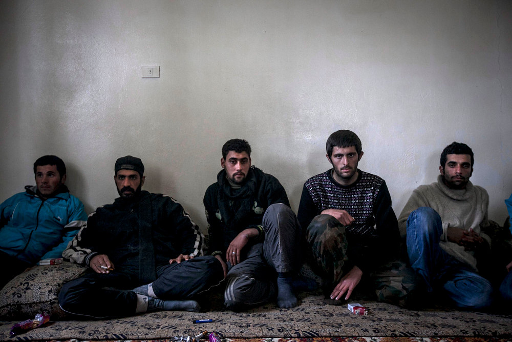 . In this Wednesday, Dec. 12, 2012 photo, Syrian army defectors pose for a photo while in the custody of the Free Syrian Army after they surrendered during fighting at a military academy outside of Aleppo, Syria. (AP Photo/Narciso Contreras)