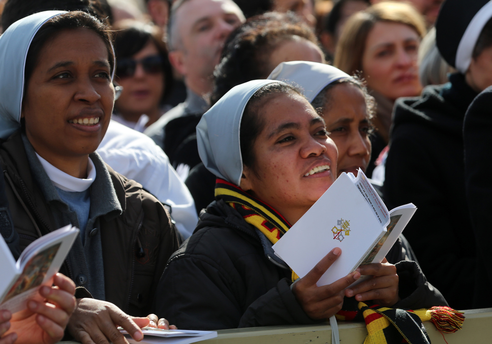 . Wellwishers gather during the Inauguration Mass for Pope Francis in St Peter\'s Square on March 19, 2013 in Vatican City, Vatican. The mass is being held in front of an expected crowd of up to one million pilgrims and faithful who have filled the square and the surrounding streets to see the former Cardinal of Buenos Aires officially take up his role as pontiff. Pope Francis� inauguration takes place in front of Cardinals and spiritual leaders as well as heads of state from around the world.  (Photo by Joe Raedle/Getty Images)