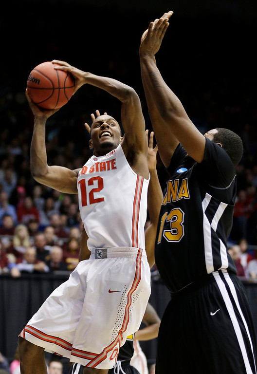 . Ohio State forward Sam Thompson (12) shoots against Iona forward David Laury (13) in the first half of a second-round game at the NCAA college basketball tournament, Friday, March 22, 2013, in Dayton, Ohio. (AP Photo/Al Behrman)