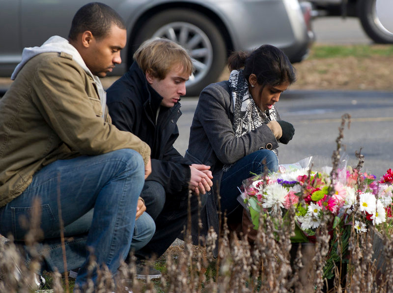 . Young people leave flowers near Sandy Hook Elementary School on December 15, 2012 in Newtown, Connecticut. The residents of an idyllic Connecticut town were reeling in horror from the massacre of 20 small children and six adults in one of the worst school shootings in US history. The heavily armed gunman shot dead 18 children inside Sandy Hook Elementary School, said Connecticut State Police spokesman Lieutenant Paul Vance. Two more died of their wounds in hospital.      DON EMMERT/AFP/Getty Images