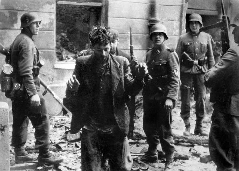 . A Jew is arrested by German soldiers in April 1943 after the uprising of the Warsaw ghetto during WWII. When the Nazis set up the ghetto in 1940, it held more than 300,000 Jews. Two years later most of them had either died from starvation or disease or been carted off to an extermination camp. (STF/AFP/Getty Images)