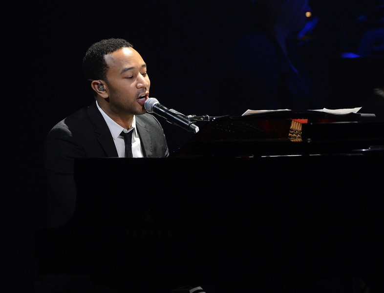 . Singer John Legend performs onstage during a celebration of Carole King and her music to benefit Paul Newman\'s The Painted Turtle Camp at the Dolby Theatre on December 4, 2012 in Hollywood, California.  (Photo by Michael Buckner/Getty Images for The Painted Turtle Camp)