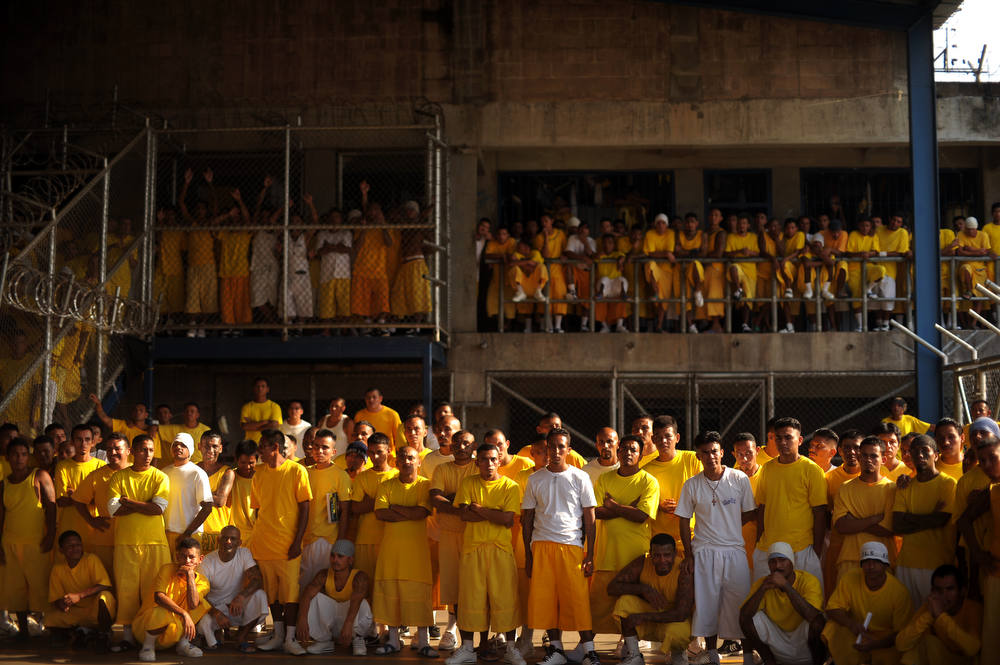 . Members of the Mara 18 gang, attend a mass at the Izalco Penitenciary in the city of Izalco, 70 Km west of San Salvador on April 13, 2012. Catholic priest Fabio Colindres, negotiator of the Catholic church, celebrated a mass to thank for the truce between the gangs Mara 18 and Mara Salvatrucha, to down murder rates in El Salvador.  AFP PHOTO/Jose  CABEZAS/AFP/Getty Images