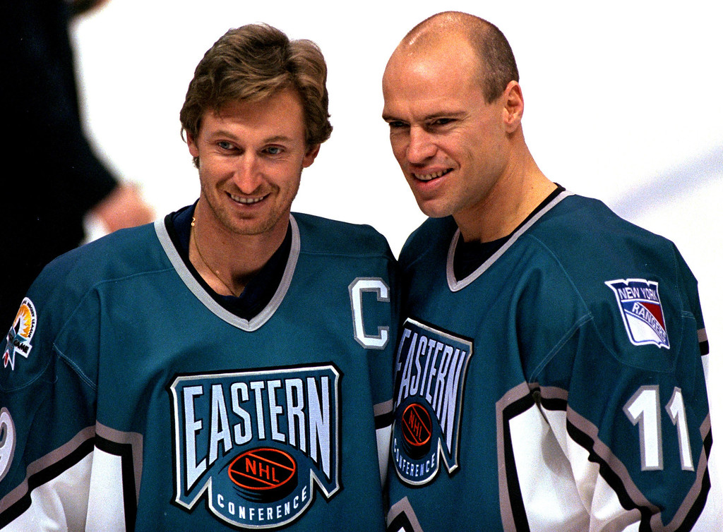 . New York Rangers center Wayne Gretzky, left, smiles with center Mark Messier during the East team practice, Jan. 17, 1997, before the NHL All-Star game at the San Jose Arena, in San Jose, Calif. (AP Photo/Paul Sakuma)