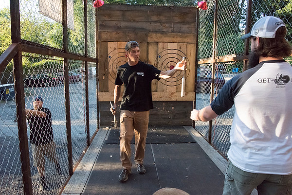 09/16/19 Wesley Bunnell | StaffrrAxe throwing was on tap Monday evening at Firefly Hollow Brewing in conjunction with Litchfield County Axe House. Litchfield County Axe House co owner Joe Kucia hands an axe to Firefly owner Dana Borque.
