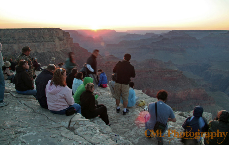 People of all nationalities come together at sunset on the rim of Grand Canyon.  Everyone is contented, happy, the cares of the world dropped away if only for a few minutes.