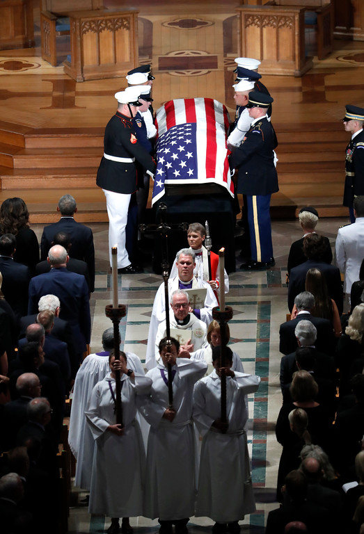 . The casket of Sen. John McCain, R-Ariz., is carried at the end of a memorial service at Washington National Cathedral in Washington, Saturday, Sept. 1, 2018. McCain died Aug. 25, from brain cancer at age 81. (AP Photo/Pablo Martinez Monsivais)