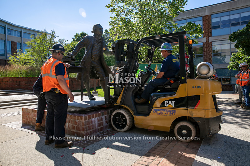 The George Mason statue was moved back to Wilkins Plaza to be part of the Enslaved People of George Mason Memorial. Photo by: Shelby Burgess/Strategic Communications/George Mason University