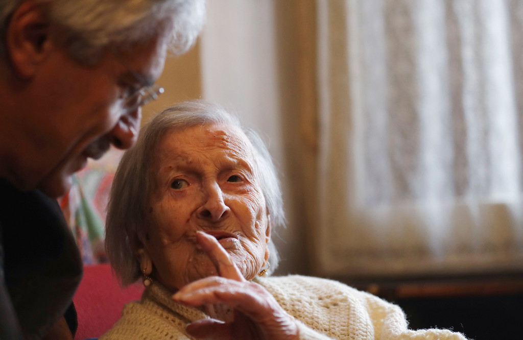 . Emma Morano, 117 years old,  talks with her physician, Carlo Bava,  in the day of her birthday in her home in Verbania, Italy, Tuesday, Nov. 29, 2016.  At 117 years of age, Emma is now the oldest person in the world and is believed to be the last surviving person in the world who was born in the 1800s, coming into the world on Nov. 29, 1899. (AP Photo/Antonio Calanni)