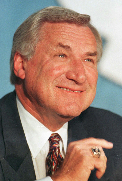 ". FILE - In an Oct. 9, 1997 file photo, North Carolina basketball coach Dean Smith smiles during a news conference in Chapel Hill, N.C.,where he announced his retirement. Smith, the North Carolina basketball coaching great who won two national championships, died ""peacefully\"" at his home Saturday night, Feb. 7, 2015, the school said in a statement Sunday from Smith\'s family. He was 83. (AP Photo/Bob Jordan, File)"