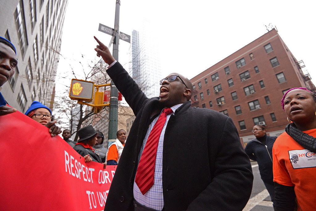 . Kendall Fells (C), organizing director of the Fast Food Forward campaign in New York, demonstrates with fast food workers and union members calling for an increase in the minimum hourly wage to 15 US dollars and the right of workers to join unions, in New York, USA, 05 December 2013.  EPA/PETER FOLEY