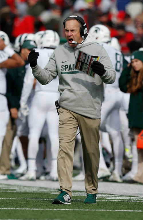 . Michigan State head coach Mark Dantonio cheers his team on against Ohio State during the first half of an NCAA college football game Saturday, Nov. 11, 2017, in Columbus, Ohio. (AP Photo/Jay LaPrete)