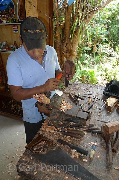 Man making carvings.jpg