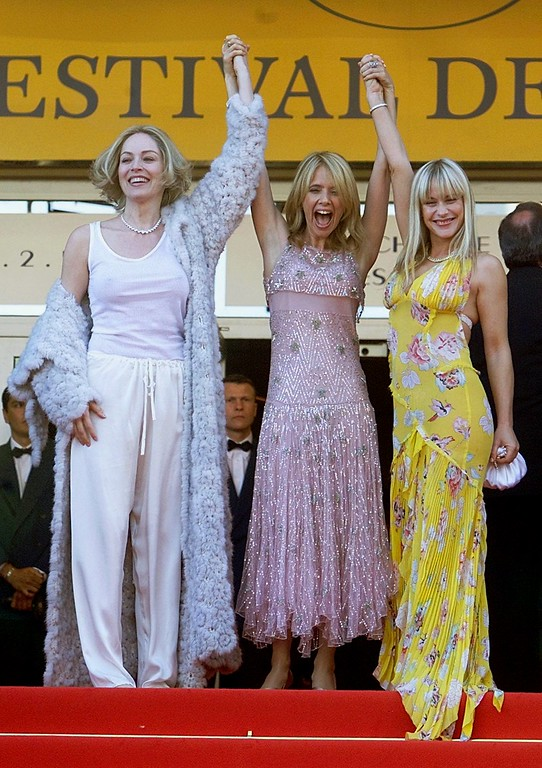 ". American film director and actress Rosanna Arquette, center, her sister Patricia, right, and American actress and Jury member Sharon Stone, left,  pose as they arrive at the Festival Palace to attend the screening of the film ""Searching for Debra Winger,\"" directed by Rosanna Arquette, which competes in the special showing category, at the 55th Film Festival in Cannes, southeastern France, Thursday, May 16, 2002. (AP Photo/Michel Euler)"