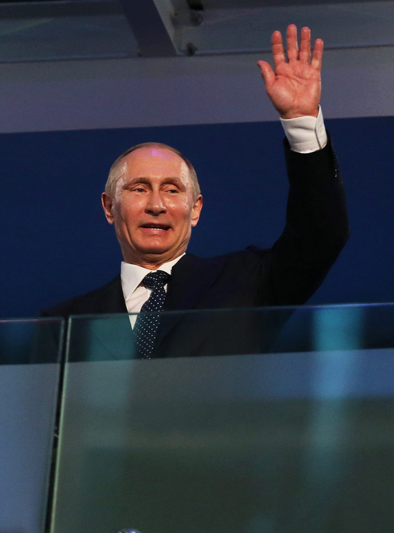 . Russian President Vladimir Putin waves during the Opening Ceremony of the Sochi 2014 Winter Paralympic Games at Fisht Olympic Stadium in Sochi, Russia, 07 March 2014.  EPA/SERGEI CHIRIKOV