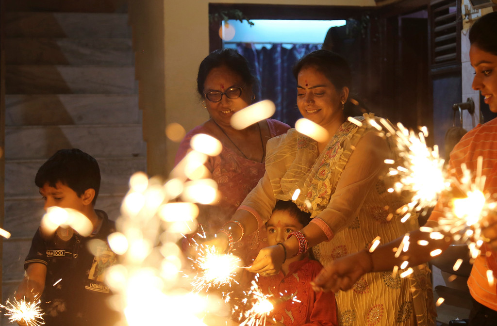 . Indians play with firecrackers during the Diwali festival in Jammu, Thursday, Oct.19, 2017. Worried especially by the impact on the health of children, the Supreme Court this year banned the sale of firecrackers, that is usually in huge demand across the country as the evening sky is lit up by the festivities. (AP Photo/Channi Anand)