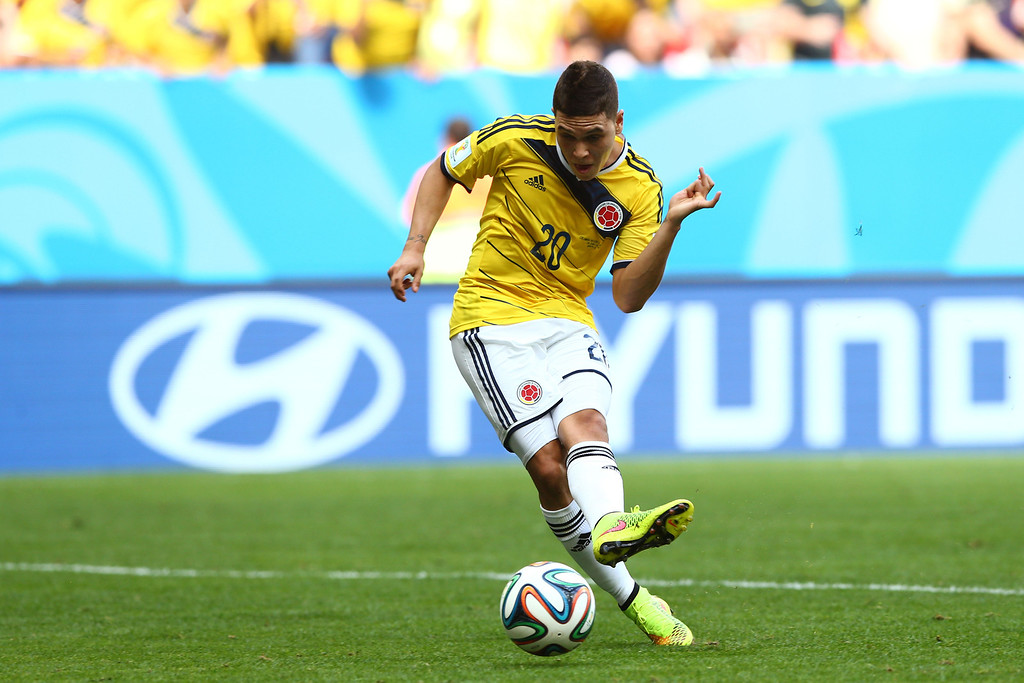 . Juan Fernando Quintero of Colombia scores his team\'s second goal during the 2014 FIFA World Cup Brazil Group C match between Colombia and Cote D\'Ivoire at Estadio Nacional on June 19, 2014 in Brasilia, Brazil.  (Photo by Elsa/Getty Images)