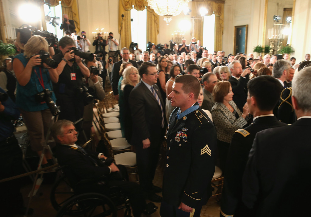 . U.S. Army Sgt. Kyle J. White walks out of the East Room after recieving the Medal of Honor from U.s. President Barack Obama during a ceremony in the East Room of the White House May 13, 2014 in Washington, DC.   (Photo by Mark Wilson/Getty Images)