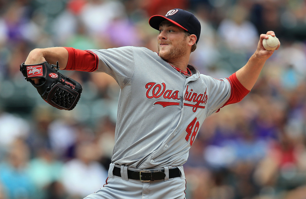 . Starting pitcher Ross Detwiler #48 of the Washington Nationals delivers against the Colorado Rockies at Coors Field on June 13, 2013 in Denver, Colorado.  (Photo by Doug Pensinger/Getty Images)