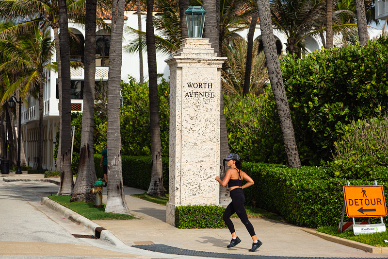 A jogger turns onto Worth Avenue from S. Ocean Blvd. in Palm Beach, April 23, 2020. All of the retail stores on Worth Avenue are closed due to the coronavirus pandemic. [JOSEPH FORZANO/palmbeachdailynews.com]
