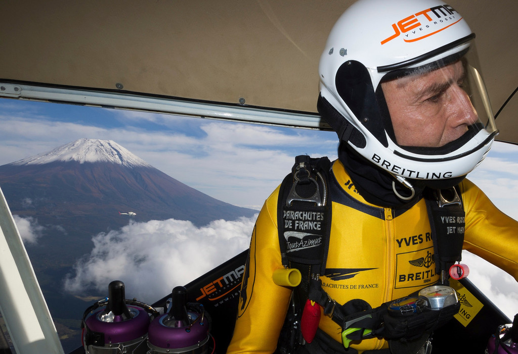 . In this photo taken Friday, Oct. 30, 2013 and provided by Breitling, Yves Rossy, known as the Jetman, gets ready to jump from a helicopter near Mount Fuji in Japan. (AP Photo/Andre Bernet, Breitling)