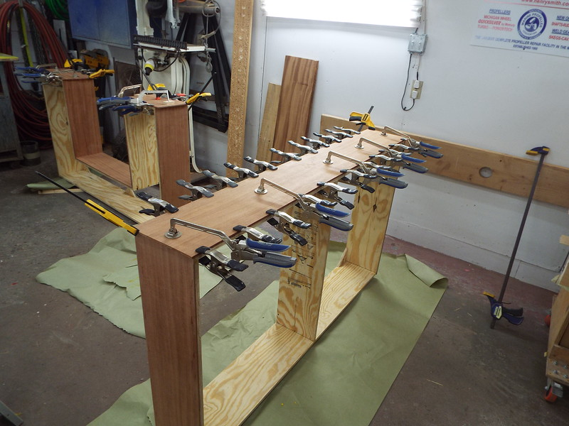 More Mahogany skin being glued to the basses.