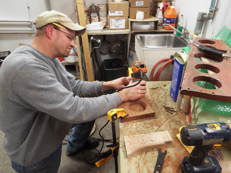 Routing a sample piece after we made a custom router bit.