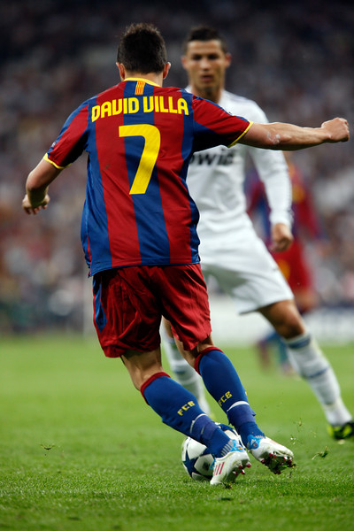 David Villa trying to dribble past Cristiano Ronaldo, UEFA Champions League Semifinals game between Real Madrid and FC Barcelona, Bernabeu Stadiumn, Madrid, Spain