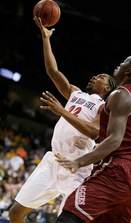 . San Diego Stateís Josh Davis (22) shoots a layup against New Mexico Stateís Tshilidzi Nephawe during the first half of a second-round game of the NCAA men\'s college basketball tournament in Spokane, Wash., Thursday, March 20, 2014. (AP Photo/Young Kwak)