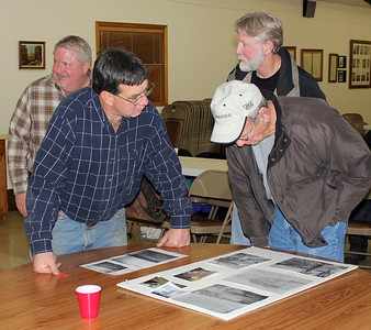 Attendees examining some of the photographs and articles that Billy Evans share with the historical society.             Return to   Spearfish Area Historical Society or continue below for more photos from earlier society programs.