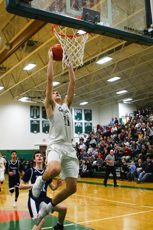 . 2018 - Basketball - Benedictine at Lake Catholic.  Benedictine defeated Lake Catholic 63-56.  Lake Catholic\'s Luka Eller (11) dunks the ball.