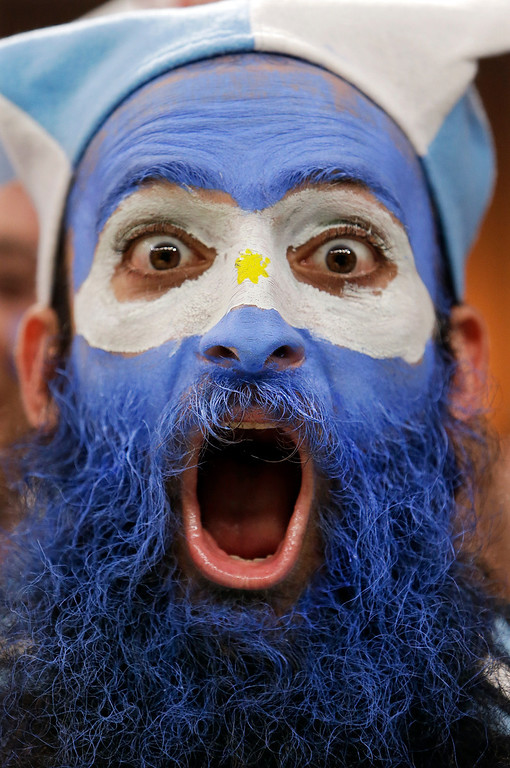 . An Argentine supporter yells during the group F World Cup soccer match between Argentina and Bosnia at the Maracana Stadium in Rio de Janeiro, Brazil, Sunday, June 15, 2014. (AP Photo/Thanassis Stavrakis)