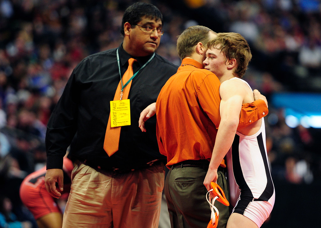 . Hunter Matney of Ponderosa is consoled by coaches after losing the Class 5A 120 pound division to Jordan Martinez of Pine Creek during the finals of the 2016 Colorado Wrestling State Championships at the Pepsi Center on February 20, 2016 in Denver, Colorado. (Photo by Brent Lewis/The Denver Post)