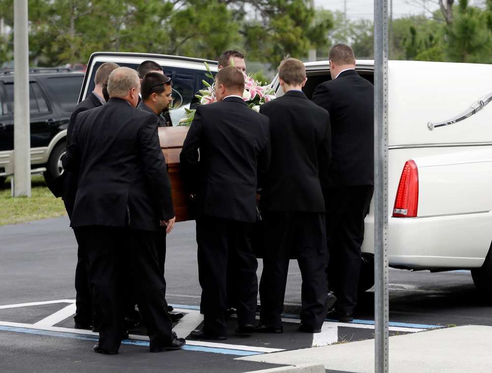 Description of . Pall bearers place the casket of country music star Mindy McCready into a hearse after a funeral ceremony at the Crossroads Baptist Church in Fort Myers, Fla., Tuesday, Feb. 26, 2013.  McCready committed suicide on Feb. 17 at her home in Arkansas, days after leaving a court-ordered substance abuse program. (AP Photo/Alan Diaz)