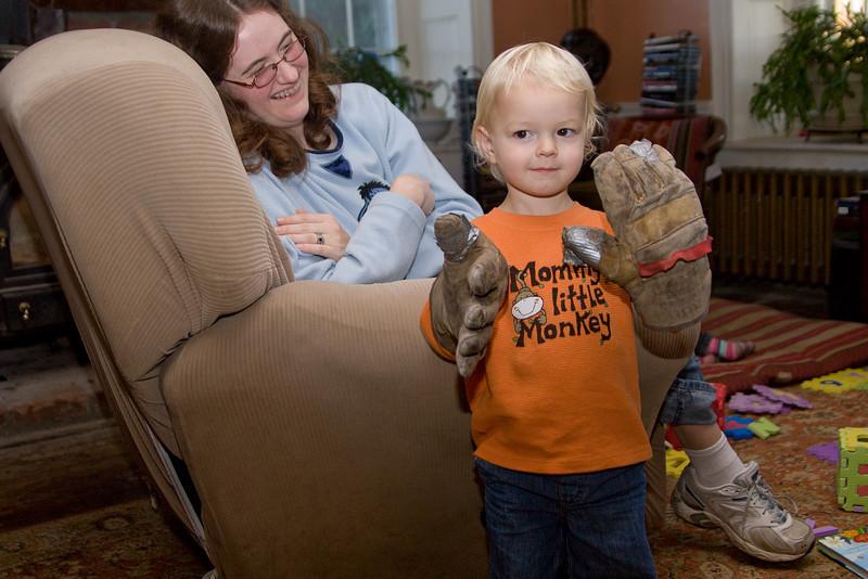 Quinton tries on Grandpop's work gloves