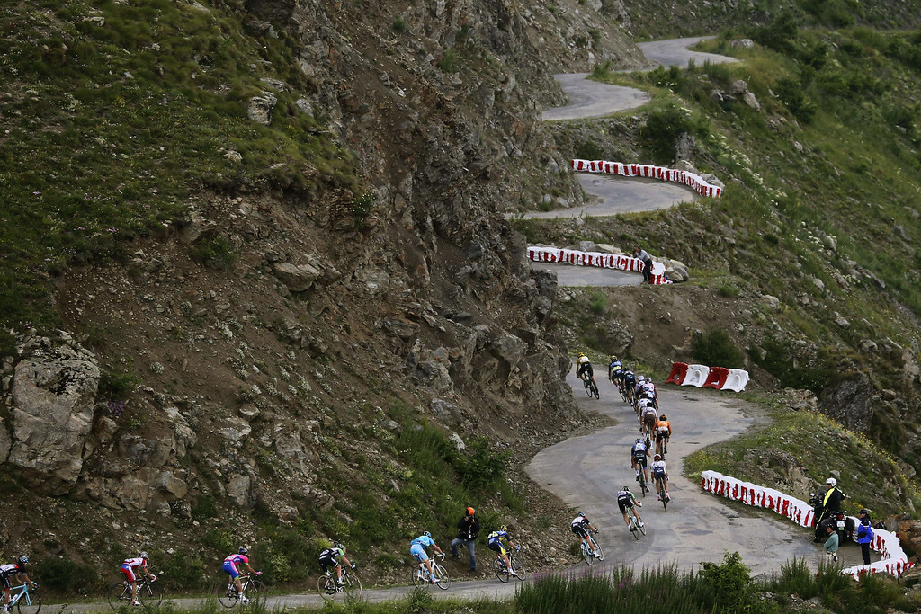 . The pack rides in the Col de Sarenne during the 172.5 km eighteenth stage of the 100th edition of the Tour de France cycling race on July 18, 2013 between Gap and Alpe-d\'Huez, French Alps. JOEL SAGET/AFP/Getty Images