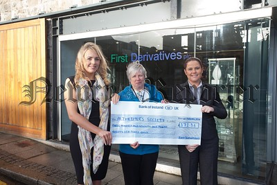 Pauline Murphy from the Alzheimers Society accepts a cheque for £371.36 from Shannon O'Hare and Rita Rice at First Derivatives money raised through a dress down day held in November. R1605026