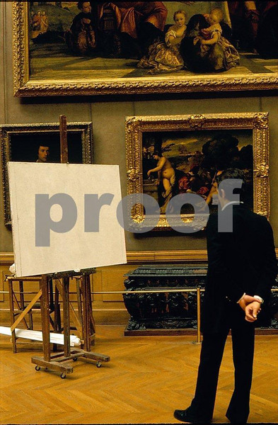 Louvre in Paris, man studying a blank canvas.