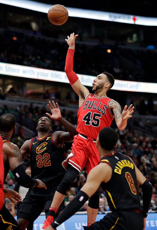 . Chicago Bulls guard Denzel Valentine (45) shoots against the Cleveland Cavaliers during the second half of an NBA basketball game Saturday, March 17, 2018, in Chicago. The Cavaliers won114-109. (AP Photo/Nam Y. Huh)